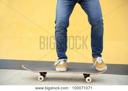 close up of skateboarding legs at skatepark