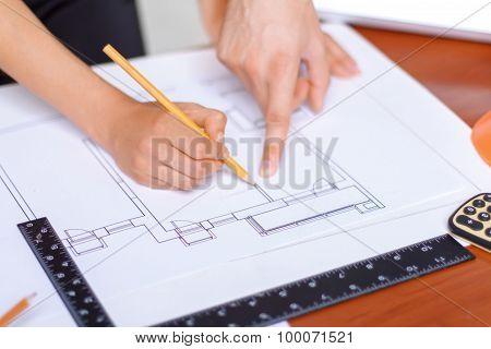 Professional architect making drawing