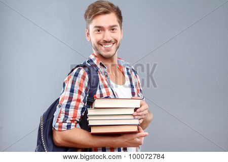 Positive student holding books