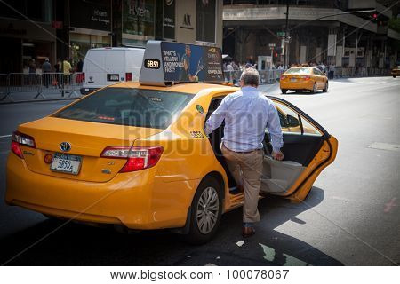 NEW YORK CITY, USA - SEPTEMBER, 2014: Male person taking a yellow cab in New York City