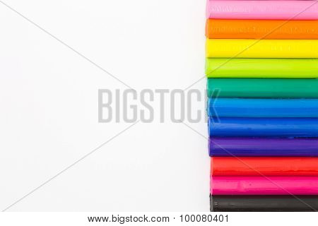Child's play rainbow colours clay on white background