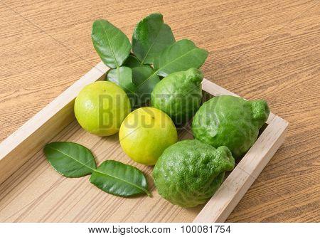 Fresh Kaffir Lime With Lemon Lime On Wooden Tray