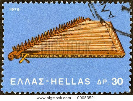 GREECE - CIRCA 1975: A stamp printed in Greece shows a Kanonaki (santouri) musical instrument