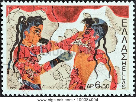 GREECE - CIRCA 1973: A stamp printed in Greece shows boxing boys (fresco)