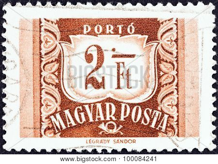 HUNGARY - CIRCA 1958: A stamp printed in Hungary shows value and posthorn