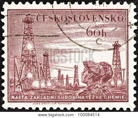 CZECHOSLOVAKIA - CIRCA 1953: A stamp printed in Czechoslovakia shows Miners and colliery shaft head