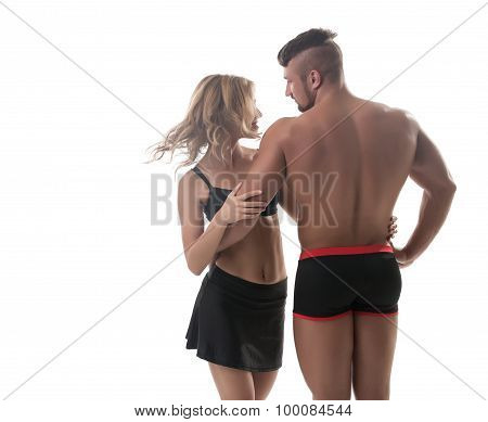 Athletic couple. Muscular man and pretty blonde