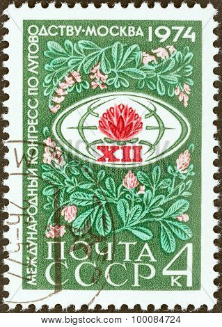 USSR - CIRCA 1974: A stamp printed in USSR shows Congress Emblem within Lucerne Grass