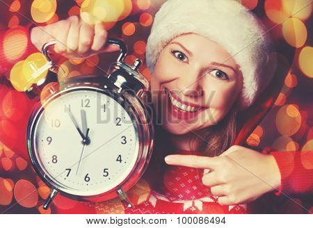 Merry Christmas! Woman In Christmas Hat With Alarm Clock