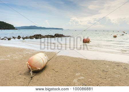 Old Buoy On Sand Beach