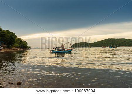 Fishing Boat Lies On The Sea