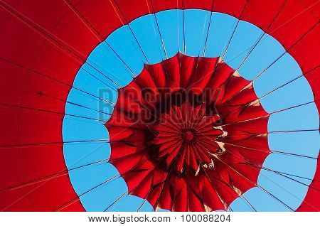 Pattern on top of a red balloon