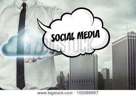 Social media text on cloud computing theme with businessman