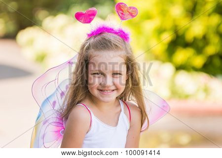 Happy Four-year Girl Playing In Fairy