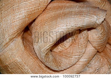 abstract background luxury cloth or circle flower wave or wavy folds of Cream silk cloth texture