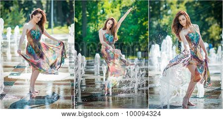 Attractive girl in multicolored short dress playing with water in a summer hottest day