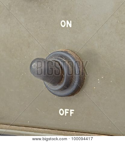 Old Black Toggle Switch On Green Surface - On