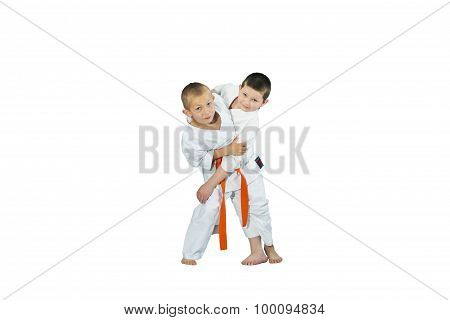 An athlete with an orange belt makes a grab for the throw