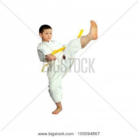 Direct kick leg is doing little athlete in karategi