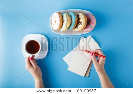 Woman Hands Painting Heart With Tea And Donuts