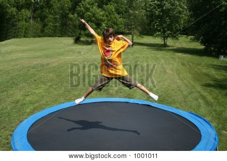 Young Boy Jumps On Trampoline