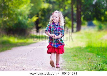 Little Girl Running In Autumn Park