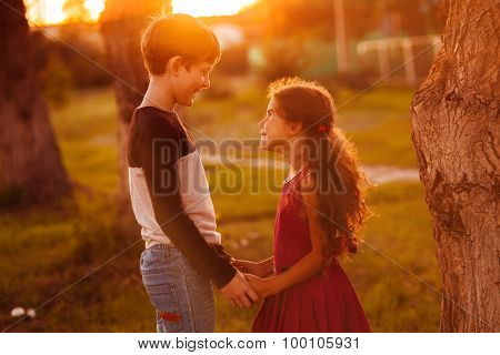 boy girl teens are holding hands romance friendship love at suns