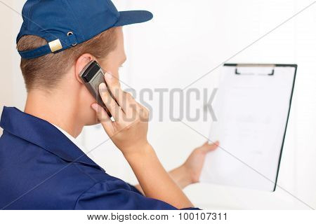 Deliveryman talking on mobile phone