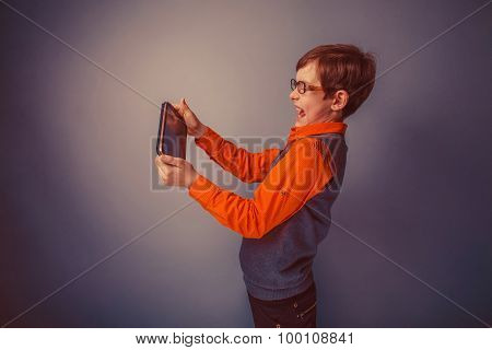 European-looking  boy of ten years  in glasses plays the plate o