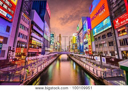 OSAKA, JAPAN - AUGUST 16, 2015: The Dotonbori Canal in the Namba District. The canals date from the early 1600's and is a popular nightlife destination.