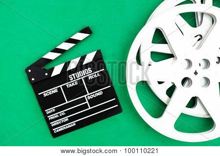 Movie Clapper Board And Reel Green Background