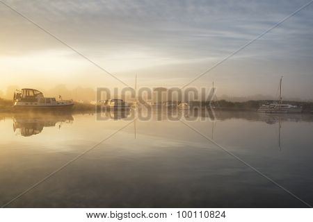 Stunning Foggy Summer Sunrise Over Peaceful River Landscape In English Countryside