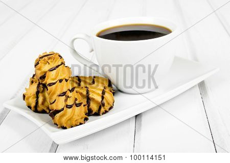 cup of coffee and delicious cookies