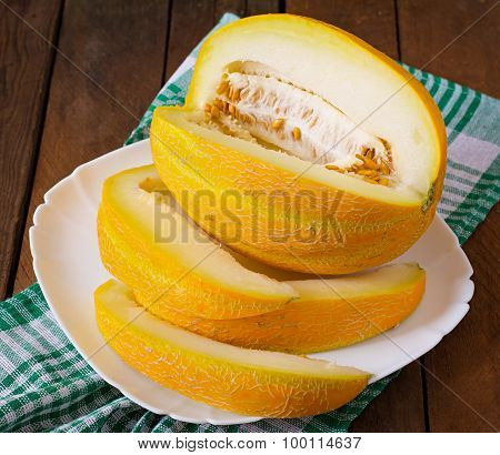 Melon cut into pieces on a plate