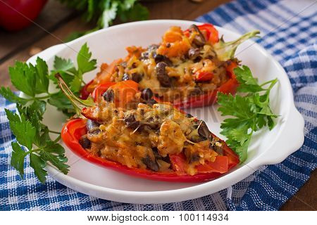 Stuffed peppers with rice, beans and pumpkin in the Mexican style