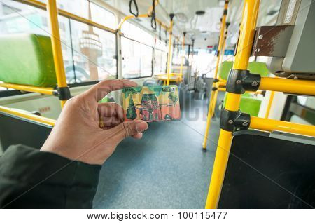 Passenger Showing T Money Card On Seoul Public Bus.