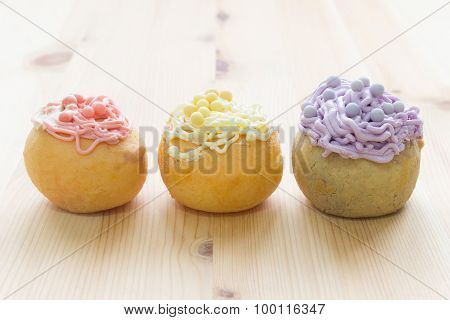 3 Color Choux Or Profiterole Or Eclair On Wood Table