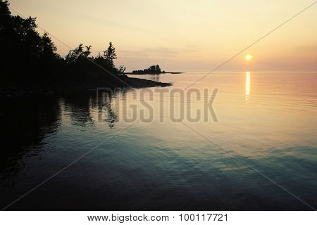 Ladoga Lake At Sunset. Aged Photo In Retro Style.