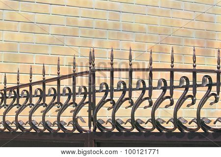 Forged Fence On Gate Against A Wall