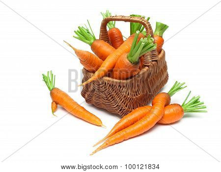 Basket With Ripe Carrots Close-up Isolated On White Background