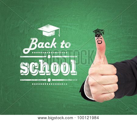 A Thumb Up With The Sketch Of The Graduation Hat And The Words: ' Back To School ' Which Are Written