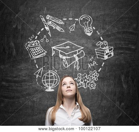 Young Beautiful Lady Thinks About Studying And Graduation. Educational Icons Are Drawn On The Black