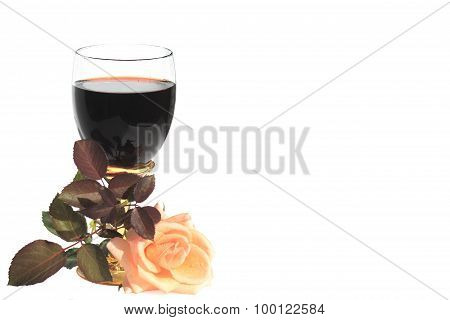 Glass Of Wonderful Wine With A Beautiful Rose