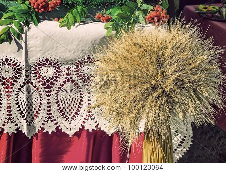 A Sheaf Of Wheat On A Background Of Lace Fabric.