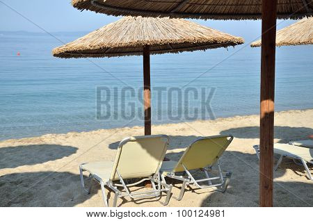 Beach Straw Parasols And Chairs