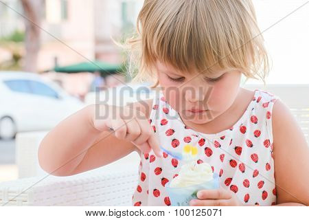 Caucasian Baby Girl Eats Frozen Yogurt