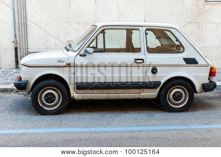 Old Light Gray Fiat 126 Parked On A Roadside