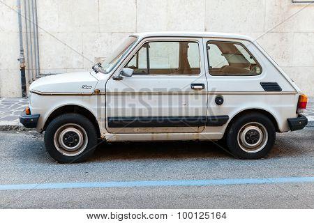 Old Light Gray Fiat 126 Parked On A Roadside