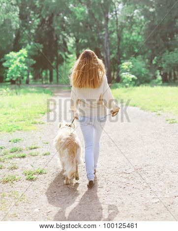 Owner And Happy Golden Retriever Dog Walking In Summer Day