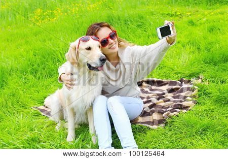 Owner Woman With Golden Retriever Dog Taking Selfie Portrait On The Smartphone In Summer Day